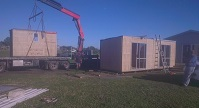 Padden Builders with there massive crane placing three of our perfect cabins made by Padden Builders
