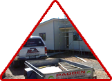Padden builder with car & trailer laying down a stunning house
